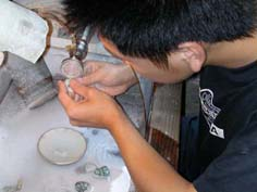 Manufacturing of jade jewelry including jade pendants and jade bangles.
