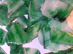 Jade stone in the rough used for manufacturing jade jewellery including jade pendants and jade bangles.